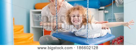 Child On Therapy Swing