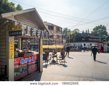 Shanghai, China - Nov 4, 2016: Near Fuyou Road - There are many small shops. The one in the foreground sells Shanghai Old Yogurt, tea and other snacks.