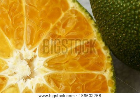 Red Citrus Fruit With Green Skin On White Background