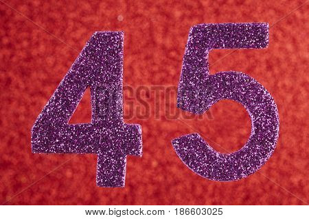 Number forty-five purple color over a red background. Anniversary. Horizontal