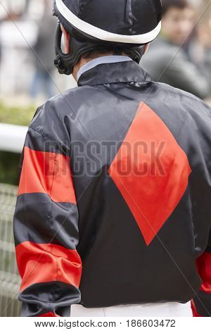 Jockey detail after the race. Hippodrome background. Racehorse. Competition