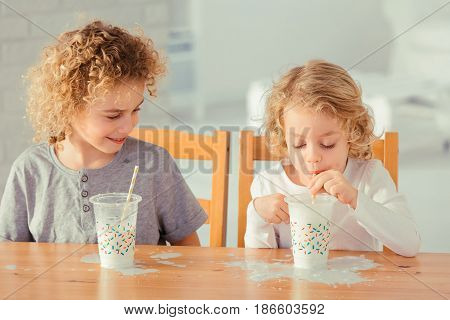 Brothers Making Mess In Kitchen