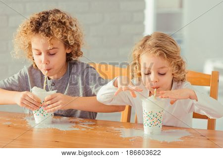Boys Spilling Milk