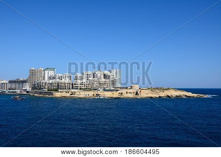 VALLETTA, MALTA - MARCH 30, 2017 - View of Fort Tigne with modern buildings to the rear seen from Valletta Sliema Malta Europe, March 30, 2017.