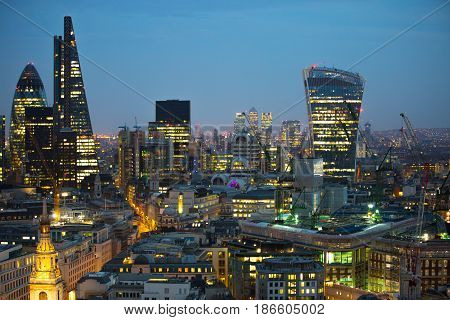 London, UK - December 19, 2016: City of London business aria view at sunset. City of London the leading financial centre in the Europe.