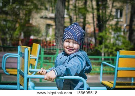 A little boy in a playground sunny day filtered shot
