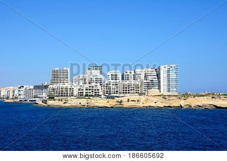 View of Fort Tigne with modern buildings to the rear seen from Valletta Sliema Malta Europe.