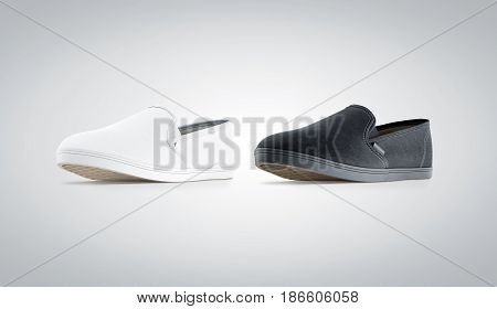 Blank black and white slip-on shoe mock up isolated 3d rendering. Plain hipster slipon mockup template stand profile view. Urban skate shoes design with clear label presentation.