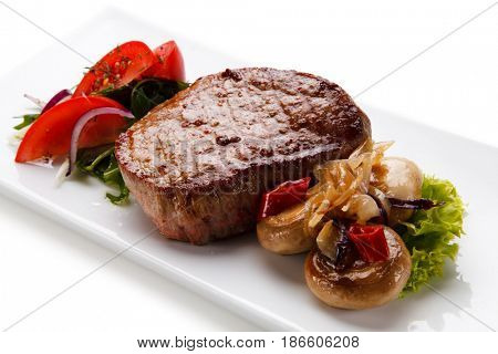 Grilled beefsteak with mushroom on white background