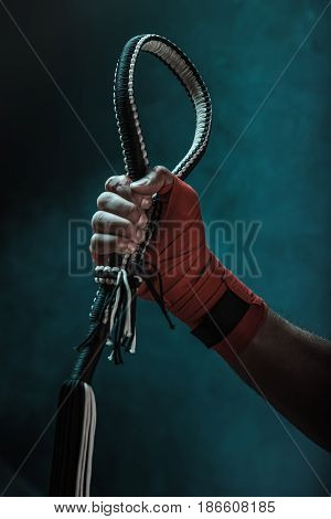 Close-up Partial View Of Muay Thai Fighter Holding Mongkhon, Action Sport Concept