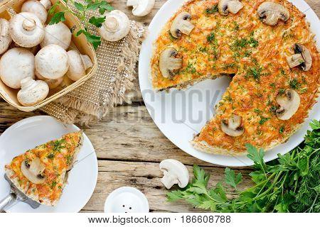 Delicious mushroom pie with champignon top view