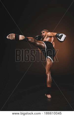 Side View Of Muay Thai Fighter Practicing Kick, Action Sport Concept