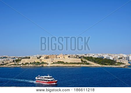 VALLETTA, MALTA - MARCH 30, 2017 - View of Manoel Fort on Manoel Island seen from Valletta with Sleima to the rear Valletta Malta Europe, March 30, 2017.