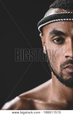 Partial View Of Confident Muay Thai Fighter With Mongkhon On Head Isolated On Black