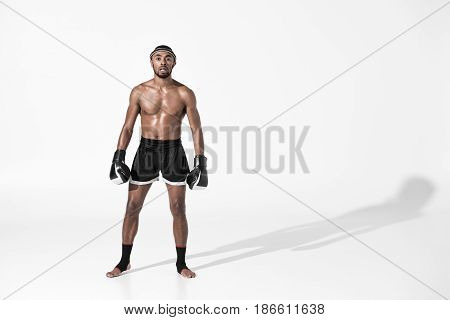 Tired Muay Thai Fighter In Boxing Gloves Isolated On White