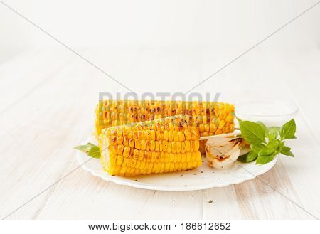 Corn Roasted On The Grill And Grilled Onions