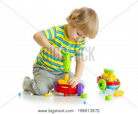 Cute child boy playing with educational isolated on white background.