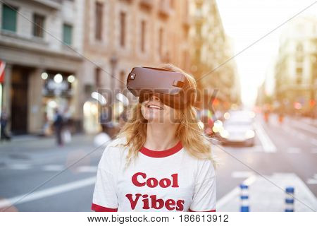 Cute hipster can not believe her eyes while experiencing augmented reality googles for the first time