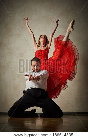 Female ballet dancer and male latin dancer mix the styles together.