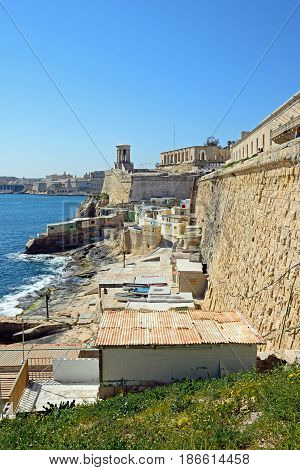 VALLETTA, MALTA - MARCH 30, 2017 - View along the waterfront towards the Siege Memorial bell tower Valletta Malta Europe, March 30, 2017.