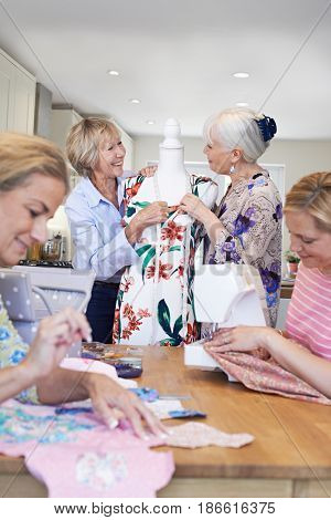 Group Of Female Friends Meeting At Sewing Circle