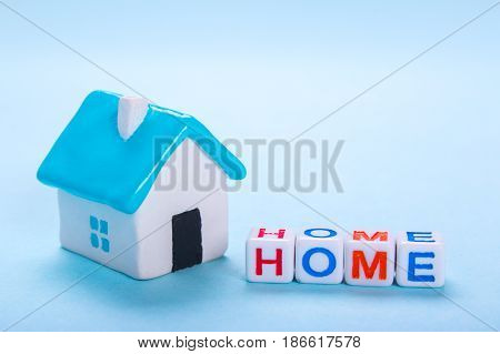 Sweet house on a blue background. House for a family for sale or for rent. Empty place for text copy paste