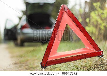 Car breakdown. Broken down car. A broken car on the side. Warning triangle