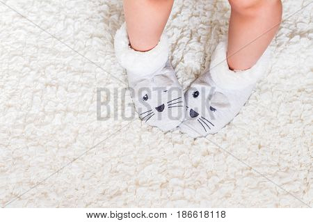 Child's feet in slippers above overhead top view