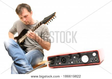 Sound card and guitarist playing music on white background