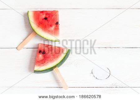 watermelon slices on sticks on wooden white background watermelon popsicle flat lay top view