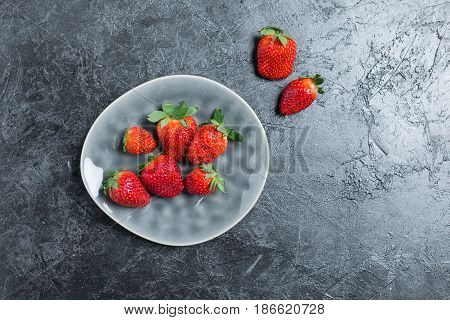 Fresh Red Strawberries On Ceramic Gray Plate. Summertime Concept, Berries Top View Concept