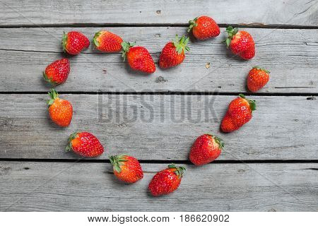 Top View Of Fresh Strawberries In Heart Shape On Wooden Tabletop, Berries On Wood Concept
