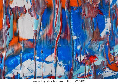 Liquid abstract paint background. Fluid painting texture. Colorful mix of acrylic vibrant colors.