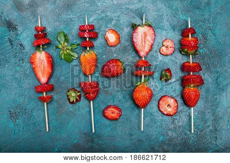 Whole Fresh Red Strawberries And Sliced Strawberries On Wooden Skewers, Berries Top View Concept