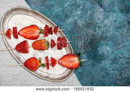 Whole Fresh Red Strawberries And Sliced Strawberries On Wooden Skewers On Vintage Plate, Berries Top