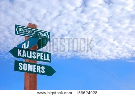 Directional sign to Kila, Kalispell, and Somers on the Rails to Trails Historical Trail of Northwest Montana.