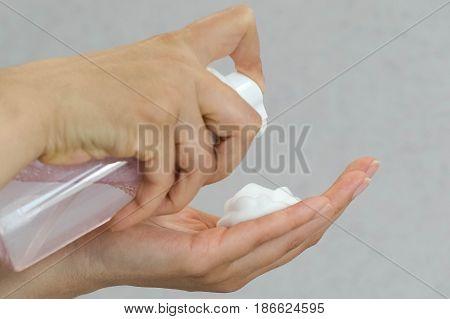 hand press pump head shampoo bottle with blur bathroom background