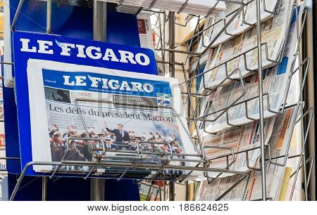PARIS FRANCE - MAY 15 2017: Le Figaro French newspaper reporting handover ceremony presidential inauguration of the newly elected French President Emmanuel Macron in Paris France