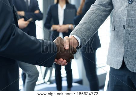 Close up of the businessmen shaking hands