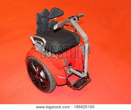 A Two Wheeled Motorised Mobility Wheelchair Scooter.