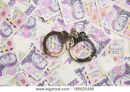 Handcuff and czech paper money. Top view.