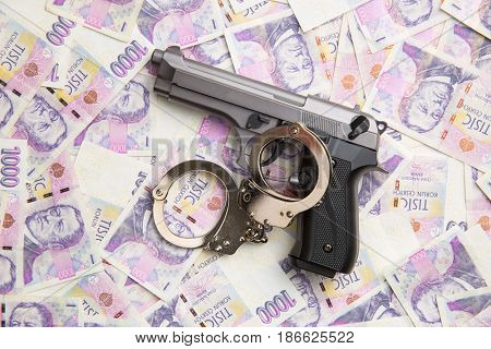 Handgun, handcuffs and czech money. Top view.