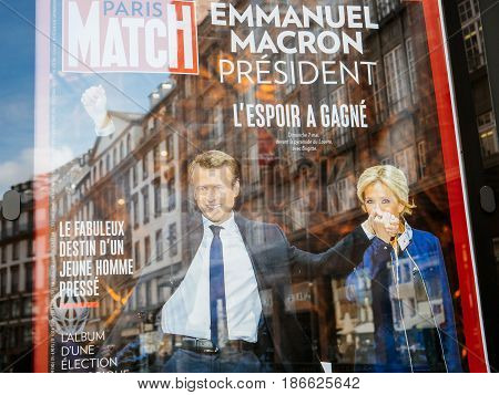 STRASBOURG FRANCE - MAY 15 2017: French city press kiosk with Paris Match magazine with Emmanuel Macron and his wife Brigitte Trogneux during handover ceremony presidential inauguration of the newly elected French President Emmanuel Macron in Paris France