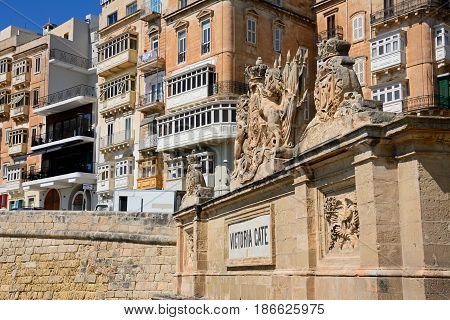 VALLETTA, MALTA - MARCH 30, 2017 - View of Victoria Gate with town buildings to the rear Valletta Malta Europe, March 30, 2017.