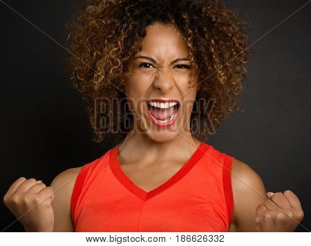 Beautiful African American woman with a happy face after receiving good news