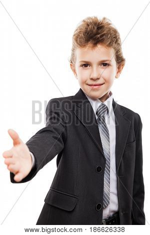Little smiling child boy in business suit gesturing hand greeting or meeting handshake white isolated