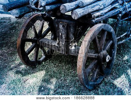 Antique wooden cart stands in the yard.