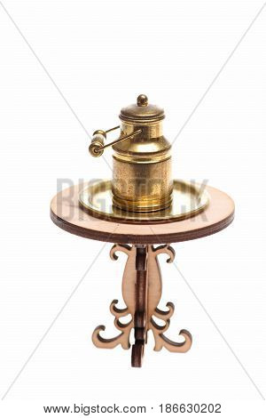 Milk Can On Golden Tray On Engraved Wooden Table