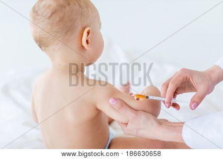 Cropped Shot Of Medical Worker Making Injection For Cute Baby Boy, 1 Year Old Baby Concept