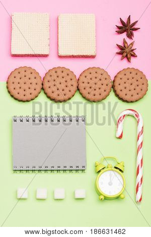 Sweets, Alarm Clock And Copybook Put Geometrically